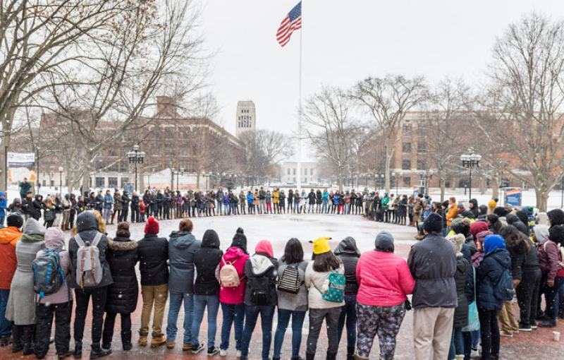 People hold hands for a unity circle during Martin Luther King Jr. Day