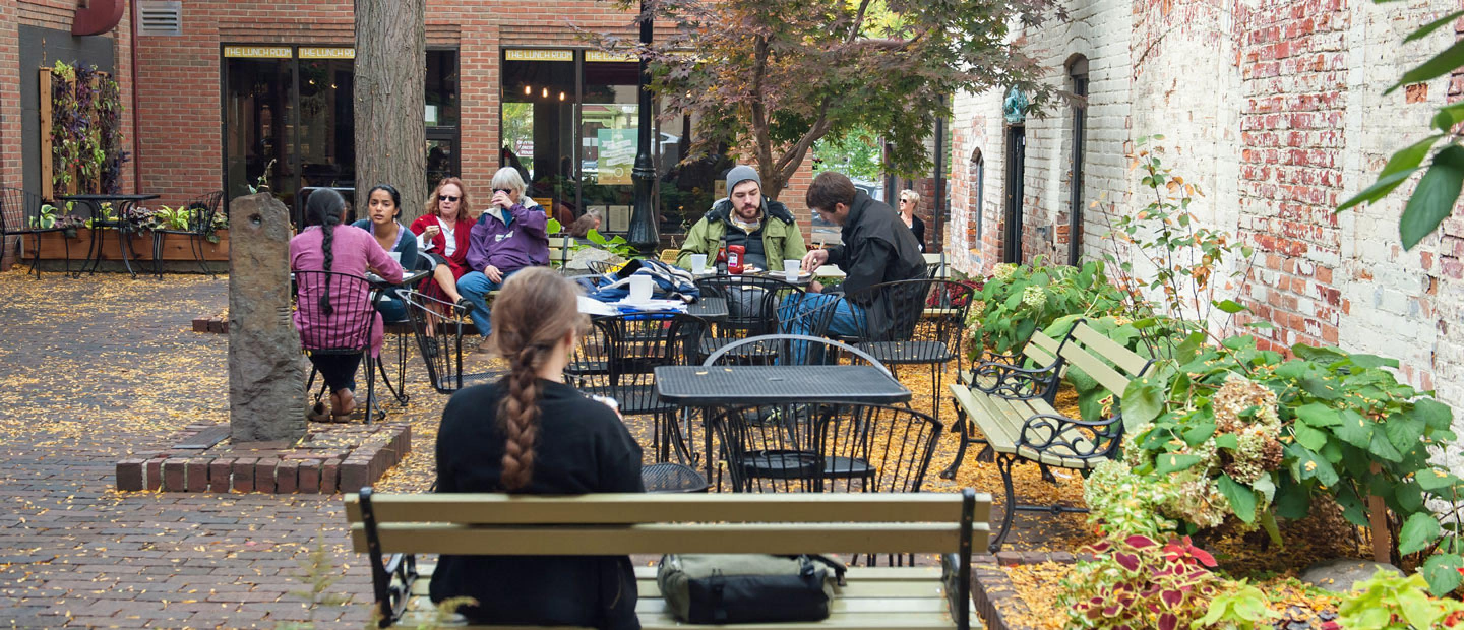 Diners in the courtyard at the Kerrytown Shops in Ann Arbor