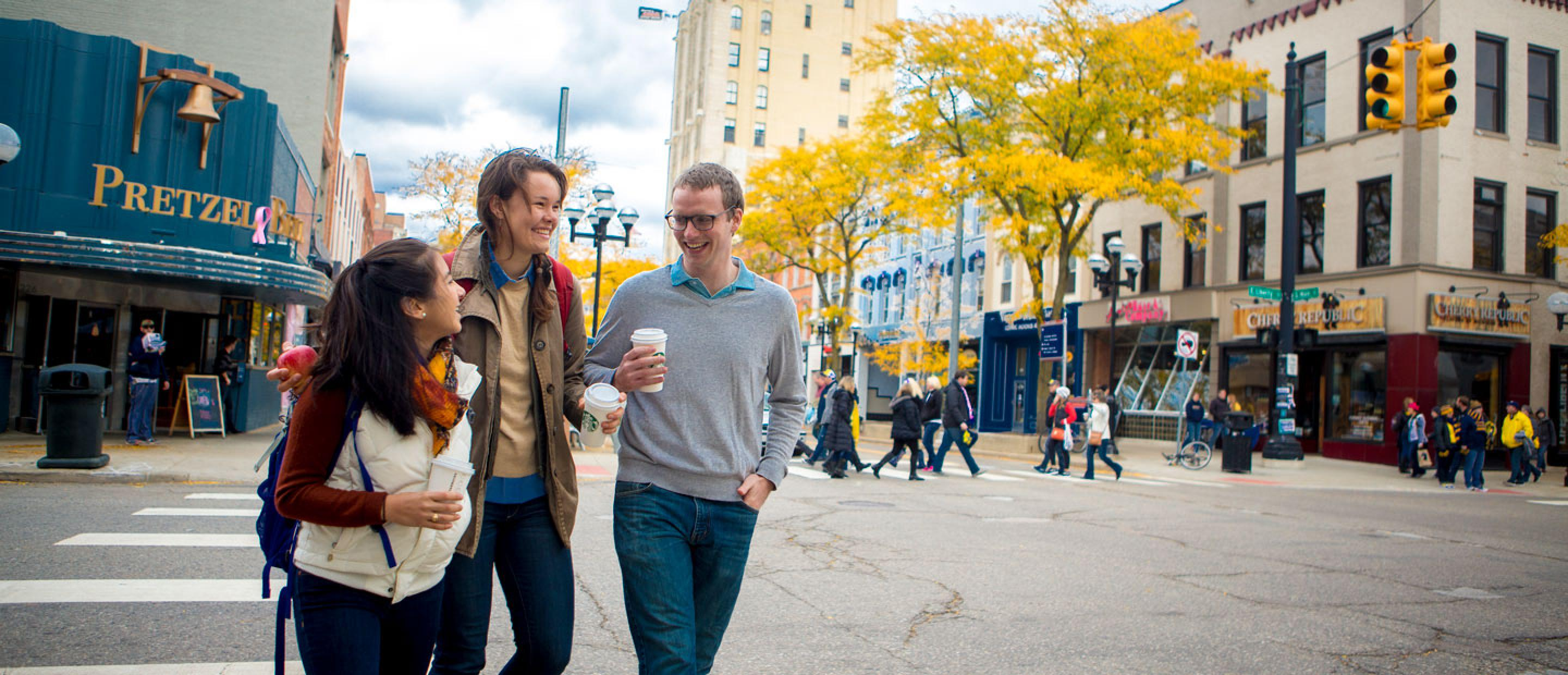 Friends walk along Main Street in downtown Ann Arbor