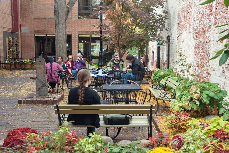 Diners in a courtyard in the Kerrytown neighborhood of Ann Arbor