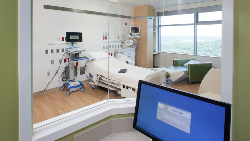 View of empty PICU room from monitoring station