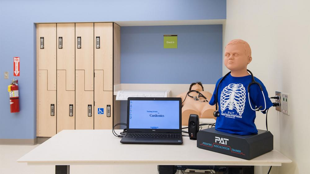 room with two different training dummies, an adult and a child with a computer simulator connected