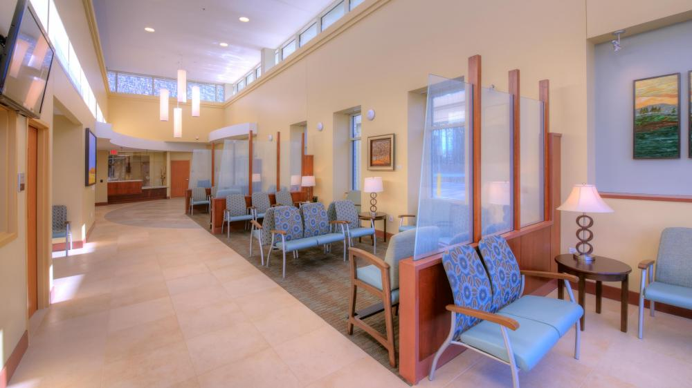 Light-filled lobby area with chairs and artwork