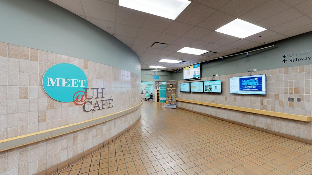 Entrance to UH Cafe with digital menus up on the walls