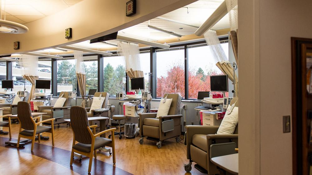 Empty infusion center with chairs separated with curtain partitions