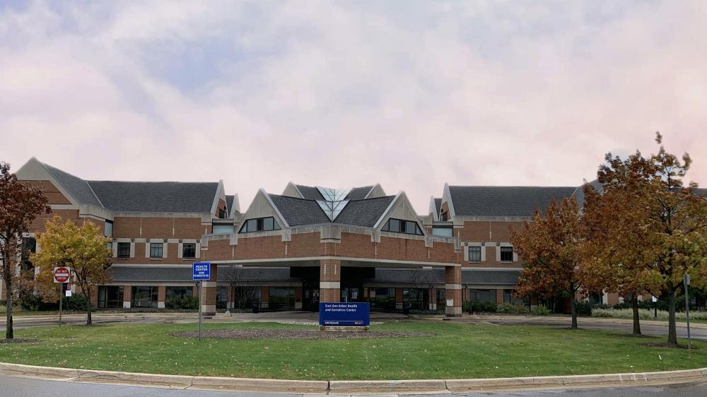 Exterior shot of East Ann Arbor Health and Geriatrics Center with sign and brick facade