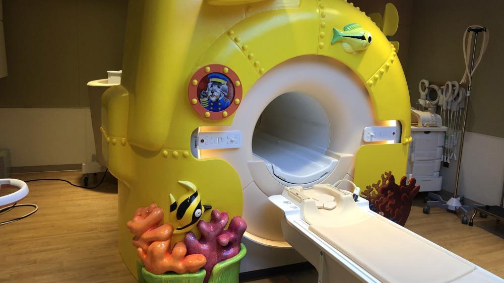 empty MRI machine decorated like a yellow submarine