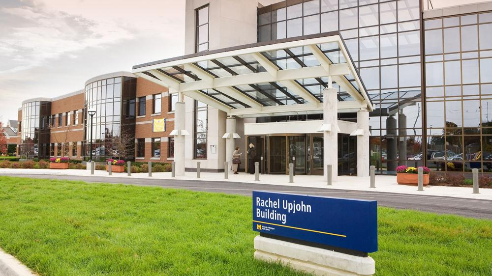 Exterior shot of Rachel Upjohn Building with sign in the foreground