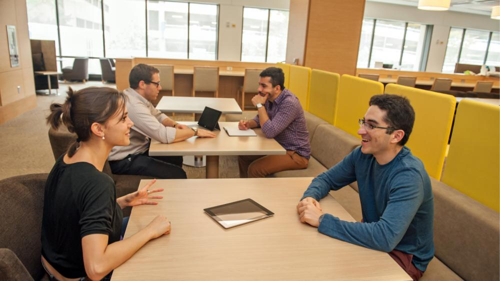 Students studying together at tables in the Taubman Health Sciences Library