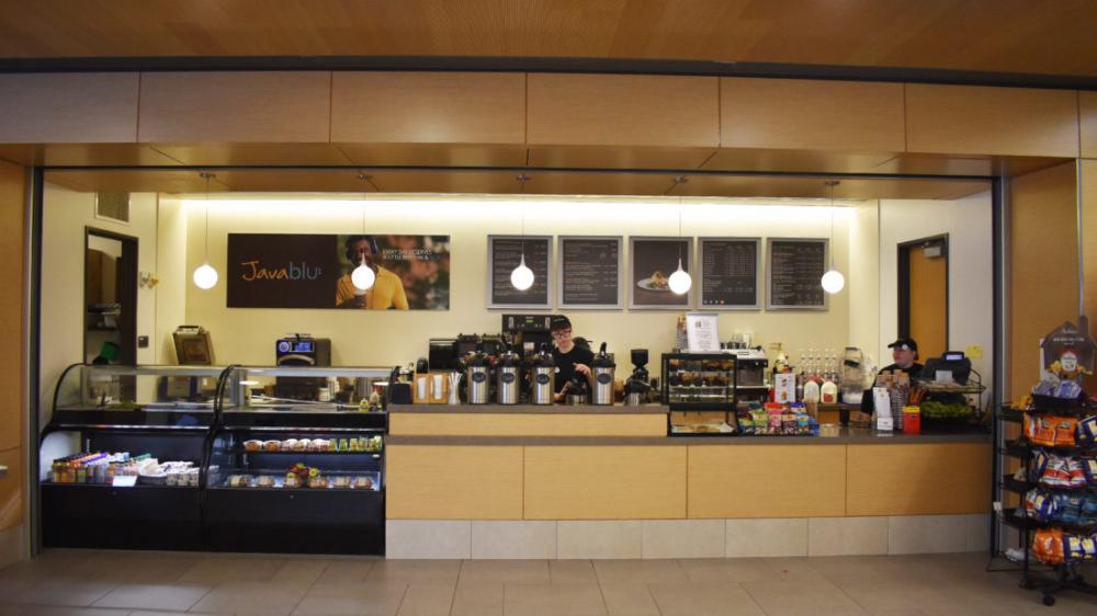 Java Blue coffee shop with counter walk-up, menu on the wall, and grab and go food options
