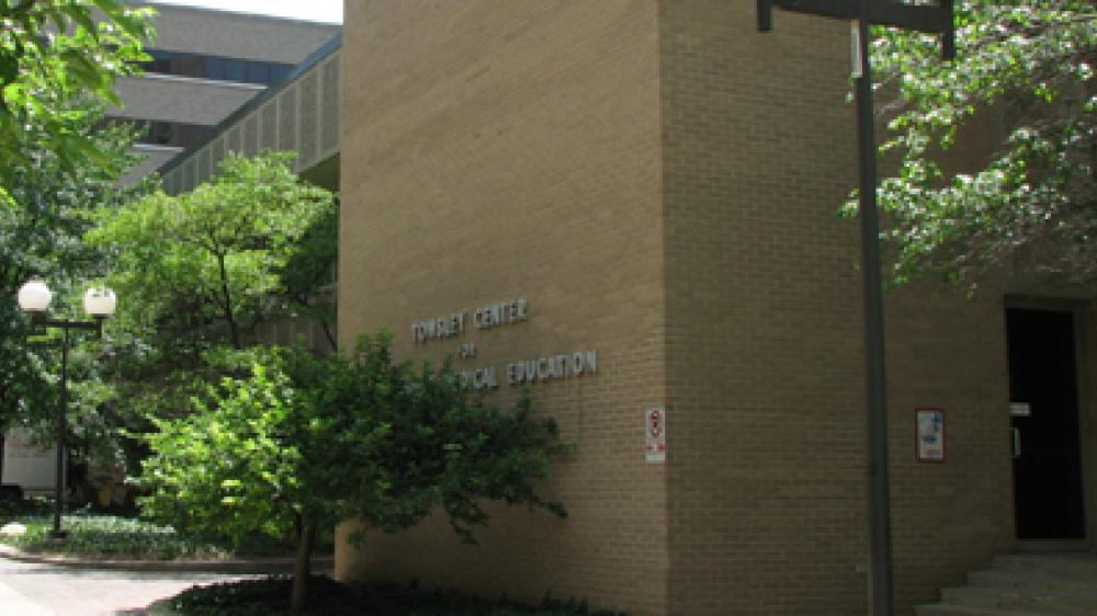 Exterior shot of Towsley Center including name on the building