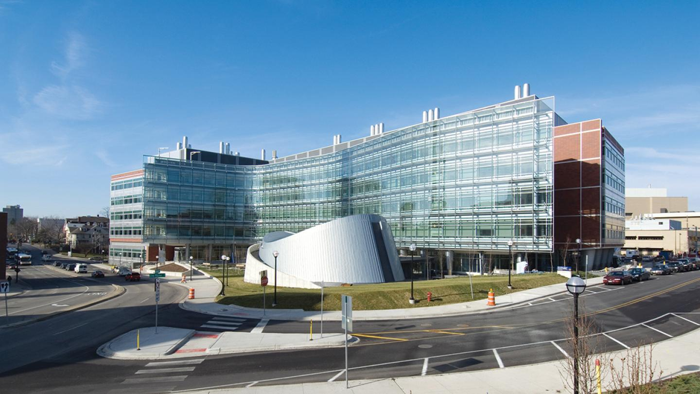 Exterior shot of Biomedical Sciences Research Building including the auditorium that looks like a pringle